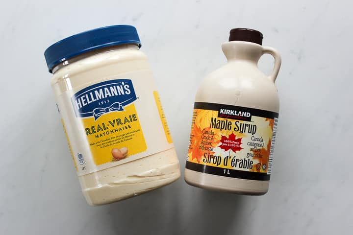 Jar of Hellman's mayonnaise and jug of Kirkland maple syrup