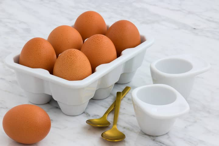 Brown eggs in ceramic egg carton