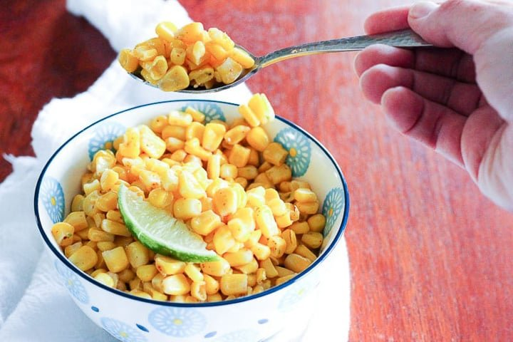 Bowl of corn with wedge of lime