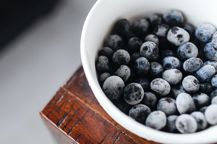 Small dish of frozen blueberries