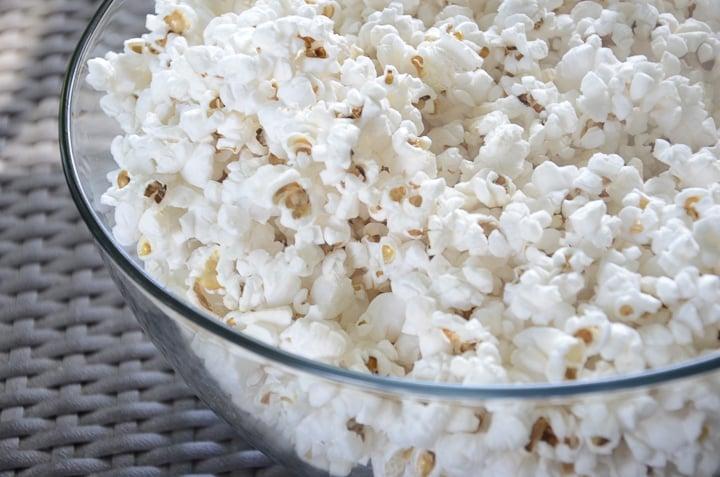 Large glass bowl of popcorn