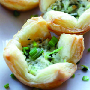 Puff pastry filled with cheese and green onions.