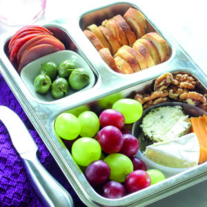 Healthy snacks inside metal rectangular pan.