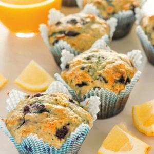 Lemon blueberry muffins and glass of orange juice