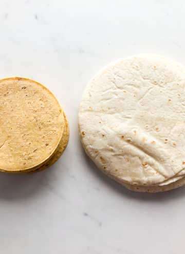 Stack of corn tortillas, stack of flour tortillas