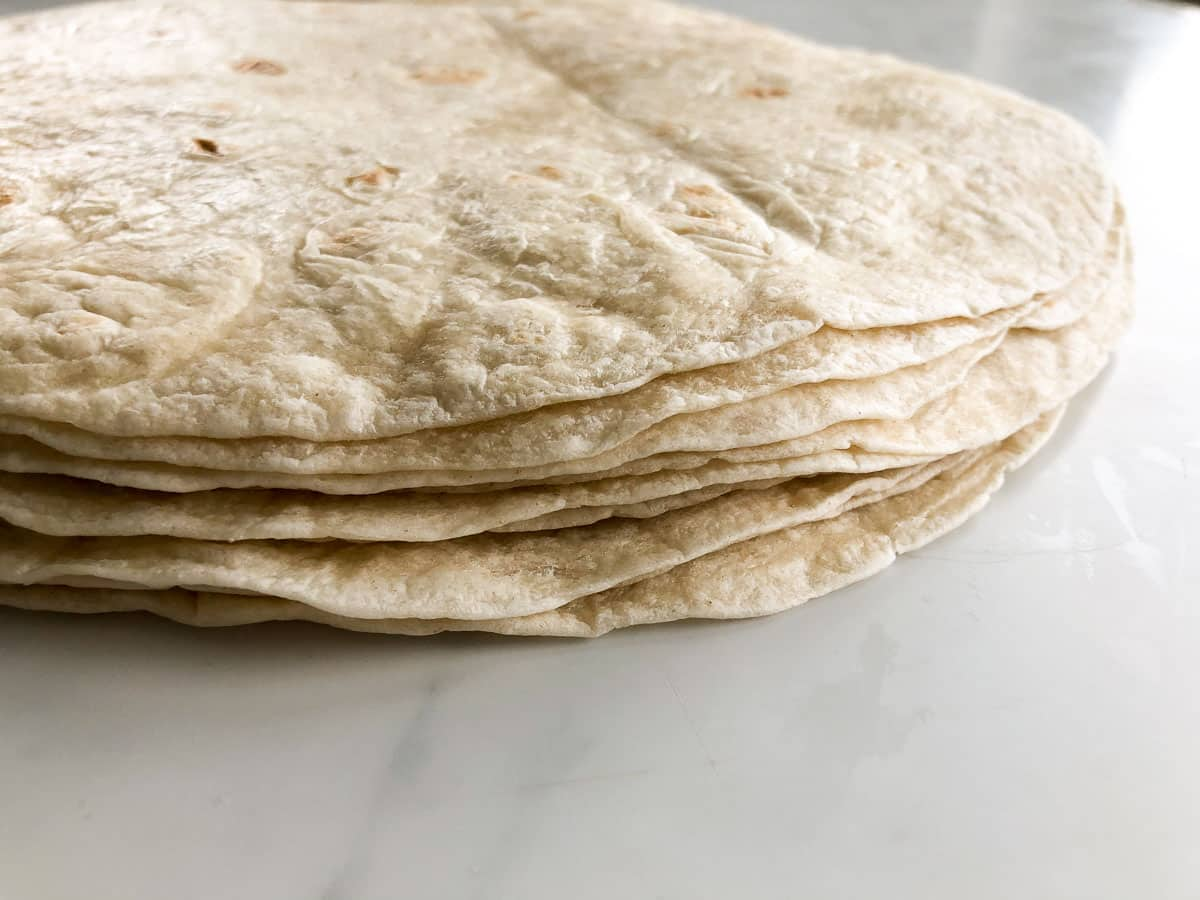 Up close picture of a stack of flour tortillas